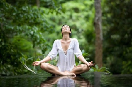 meditating-woman-in-forest-450x299