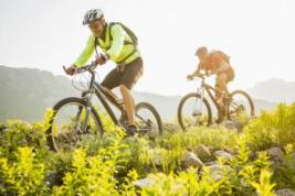 Caucasian men riding mountain bikes on trail