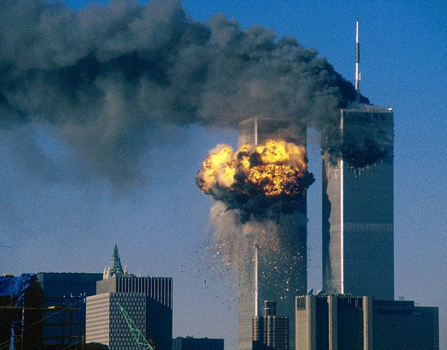 1966-1973, Financial District, New York, New York, USA --- The World Trade Center south tower (L) burst into flames after being struck by hijacked United Airlines Flight 175 as the north tower burns following an earlier attack by a hijacked airliner in New York City September 11, 2001. The stunning aerial assaults on the huge commercial complex where more than 40,000 people worked on an ordinary day were part of a coordinated attack aimed at the nation's financial heart. They destroyed one of America's most dramatic symbols of power and financial strength and left New York reeling. FOURTH OF SEVEN PHOTOGRAPHS REUTERS/Sean Adair --- Image by © Sean Adair/Reuters/CORBIS