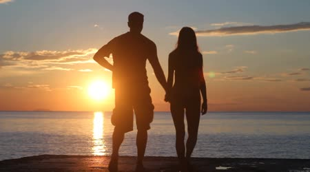 depositphotos_25438021-Couple-silhouette-at-the-beach